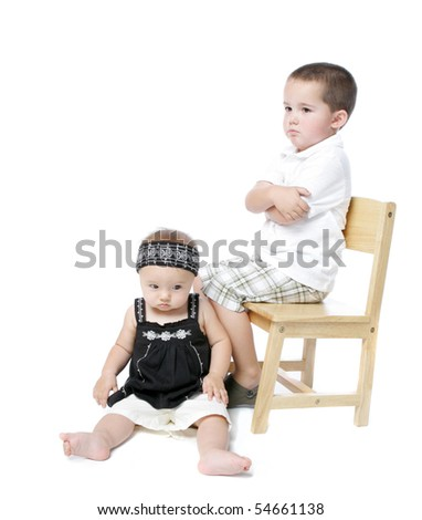 Classic portrait of a little boy and baby girl pouting - stock photo