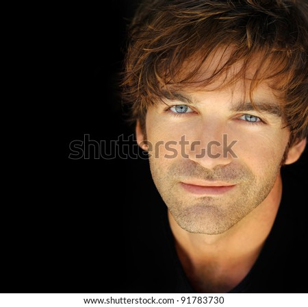 Classic portrait of a nice young man with warm expression - stock photo