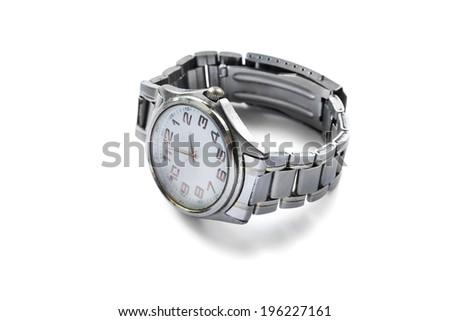 Classic quartz wristwatch on metal bracelet on white background - stock photo