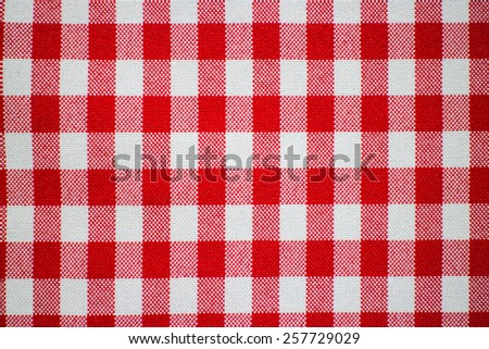 classic red and white checkered tablecloth textile - stock photo