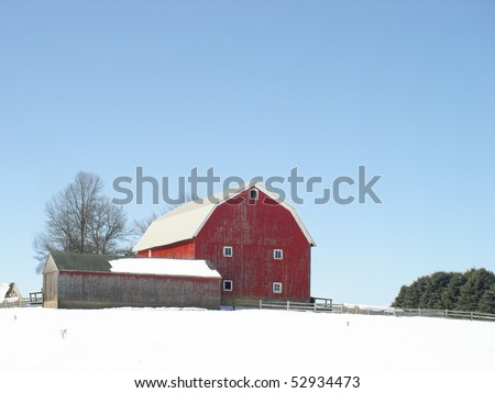 Classic red barn in winter - stock photo