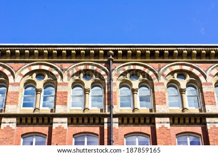 Classic red brick building in Leeds, UK - stock photo