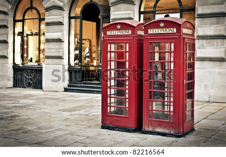 Classic red British telephone boxes in London - stock photo