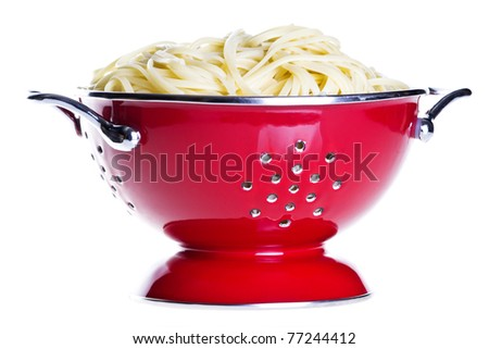 classic red colander with pasta isolated on white background - stock photo