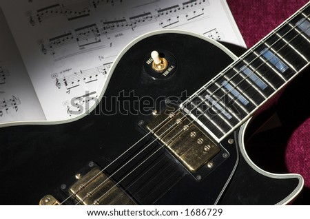 Classic rock guitar in spotlight - stock photo