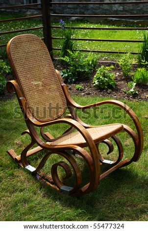 Classic rocking chair on grass - stock photo