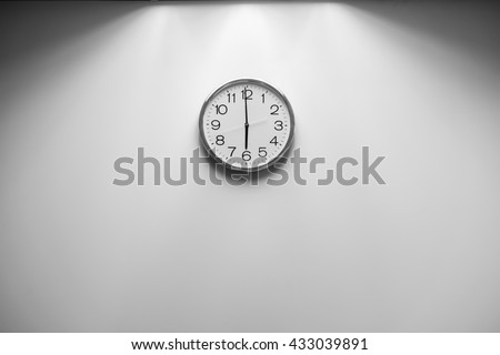 Classic round wall clock on the wall background, Black and White - stock photo