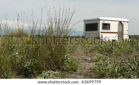 classic 1970s caravan parked by the beach in Montenegro - stock photo