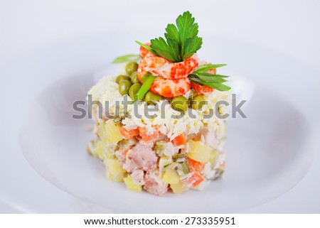 classic salad decorated with shrimp and parsley to the menu on a white background close-up delicious food - stock photo