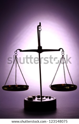 Classic scales on purple background - stock photo