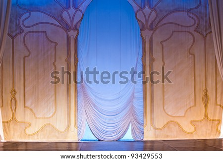 classic scenography with curtains and blue lights in old theater - stock photo