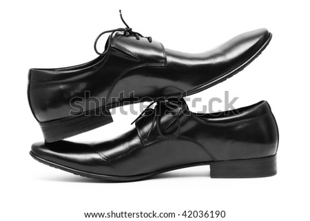 Classic shiny black men's shoes standing on each other - stock photo