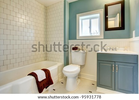 Classic simple blue bathroom with white tile. - stock photo
