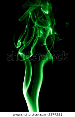 classic smoke in green on black background - stock photo