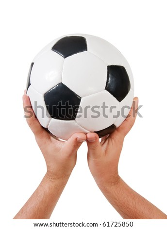 classic soccer ball in hands. Isolated over white background - stock photo