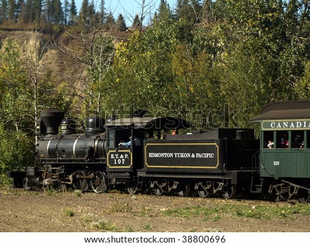 Classic steam locomotive makes its way through the North Saskatchewan River Valley at Fort Edmonton Park.  The EY&P Railroad went out of business over 100 years ago. - stock photo