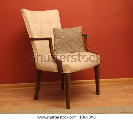 Classic style chair against red wall
