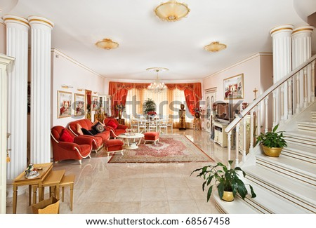 Classic style drawing-room interior in red and golden colors, view from hall - stock photo