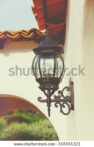 Classic style lamps on wall with retro filter effect