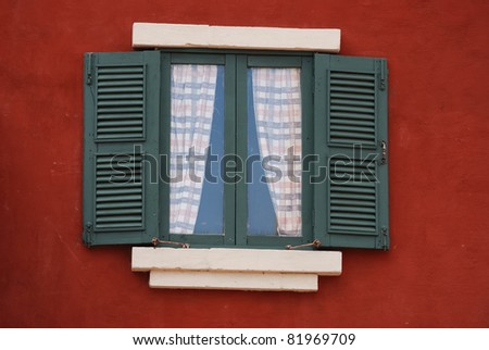 Classic style window on red cement wall - stock photo