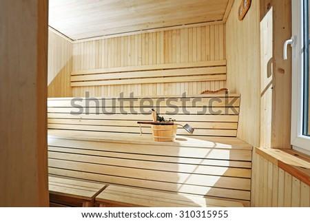 classic style wooden sauna interior - stock photo