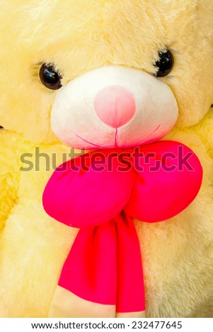 Classic teddy bear with red bow - stock photo