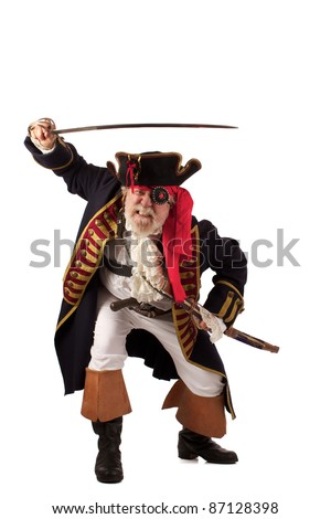 Classic 18th century bearded pirate captain lunging forward with raised sword in challenging pose. Isolated on white background with plenty of room for copy. - stock photo