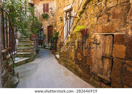 Classic Tuscan door in the village Pitigliano - stock photo