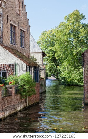 Classic view of channels of Bruges. Belgium. Medieval fairytale city. Summer urban landscape
