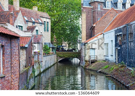Classic view of channels of Bruges. Belgium. Medieval fairytale city. Summer urban landscape - stock photo