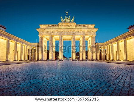 Classic view of famous Brandenburger Tor (Brandenburg Gate), one of the best-known landmarks and national symbols of Germany, in twilight during blue hour at dawn, Berlin, Germany