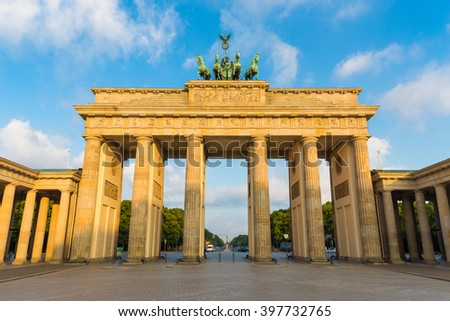 Classic view of famous Brandenburger Tor (Brandenburg Gate), one of the best-known landmarks and national symbols of Germany, in beautiful golden morning light at sunrise, Berlin, Germany