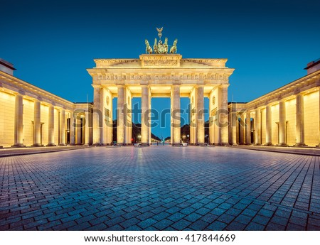 Classic view of famous Brandenburger Tor (Brandenburg Gate), one of the best-known landmarks and national symbols of Germany, in twilight during blue hour at dawn, Mitte district, Berlin, Germany - stock photo