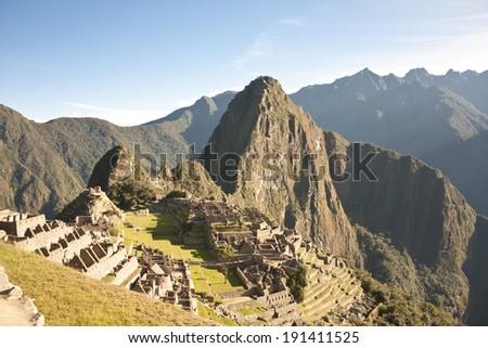 Classic view of the Inca citadel of Machu Picchu - stock photo