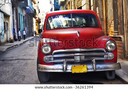 Classic vintage american car parked in the street of Old Havana - stock photo