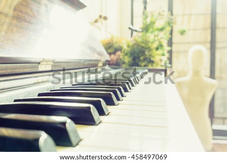 Classic vintage old piano keyboard shallow depth of field