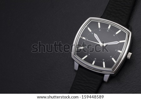 Classic watch on black background - stock photo
