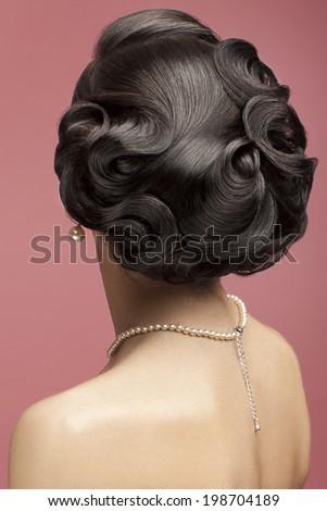 Classic wedding hairstyle. Beautiful bridal hairdo. Vintage retro style hairdo - stock photo