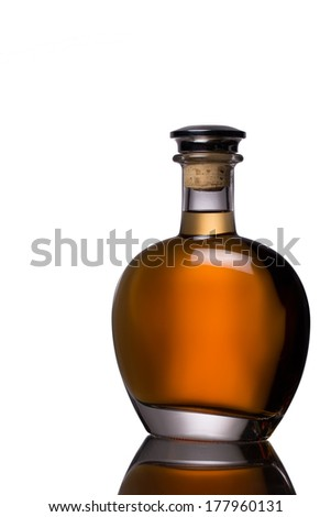 Classic whiskey bottle with whisky and reflection isolated on white - stock photo