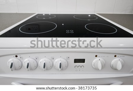 classic white four ring electric hob with dials - stock photo