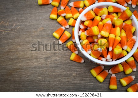 Classic white, orange and yellow candy corn sweets for Halloween with copy space. - stock photo