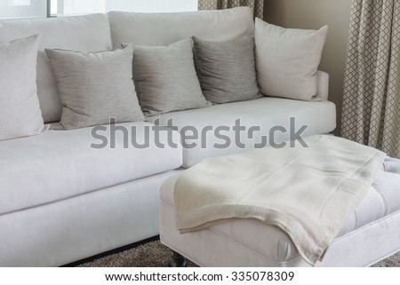 classic white sofa with pillows in living room