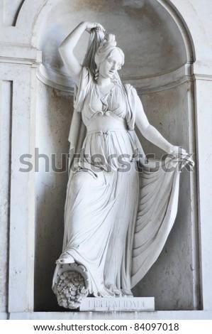 Classic white statue - patroness of generosity - stock photo
