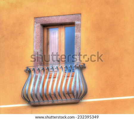classic window in a colorful wall. Shot in Bosa, Italy. Processed for hdr tone mapping effect. - stock photo