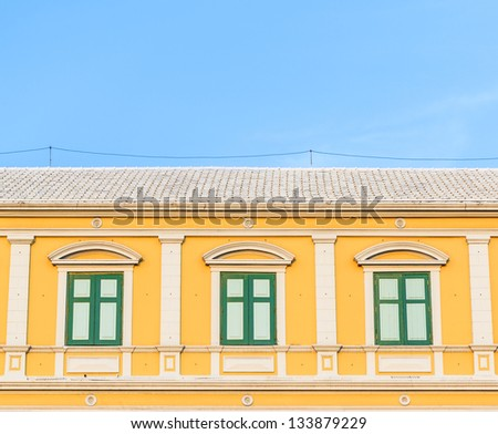 Classic window on orange wall in bangkok thailand. - stock photo