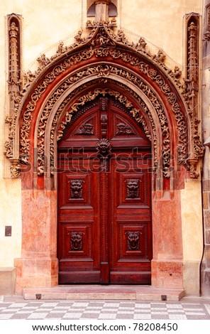 Classic wooden door, Prague - stock photo