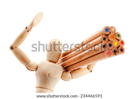 "Classic wooden dummy holds a bunch of colorful pencils like a huge lumber and raise his hand in ""Hello"" pose  isolated on white. - stock photo"