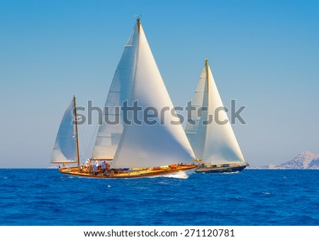 classic wooden sailing boats in a race, Spetses island in Greece - stock photo