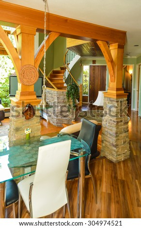 Classic wooden trim of beautiful living room interior with hardwood floor. Room view from dining area.