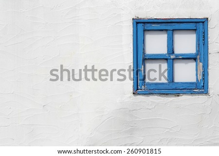 classic wooden window on the white wall - stock photo